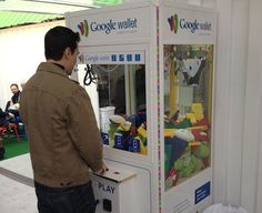Google Wallet - Google game crane with promotional items