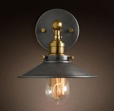 Over vanity. 20th C. Factory Filament Metal Sconce