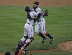 San Francisco Giants relief pitcher Romo jumps into the arms of catcher Posey after defeating the Detroit Tigers to win the MLB World Series baseball championship in Detroit