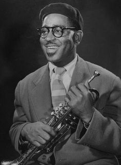 """Potriat of Dizzy Gillespie, """"bebop"""" king, holding his trumpet.  Location:Hollywood, CA, US  Date taken:September 1948  Photographer:Allan Grant"""