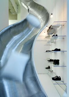 Slide in Maison Martin Margiela store..  awesome!  There really should be a lot more slides in this world