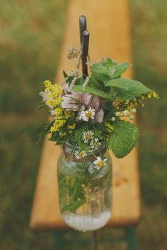 Bride wears a Charlie Brear wedding gown for an outdoor humanist ceremony on a farm & a rustic reception in a marquee with a yellow colour scheme, wild flowers & bunting | Rock My Wedding