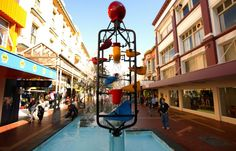 """A Wellington landmark, the Bucket Fountain (originally referred to as the """"Water Mobile""""), was erected in 1969 as a part of the Cuba Street pedestrian mall. Wellington City, Wellington New Zealand, Cuba Street, Street Art, Cheap Things To Do, Free Things, New Zealand Travel Guide, Street Installation, New Zealand Houses"""
