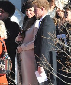 Prince Harry, seen standing beside blossoming Kate as she holds a maternal hand to her baby bump