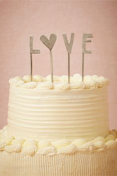 So simple! love it :) L-O-V-E Cake Topper from BHLDN #weddings #anthropologie