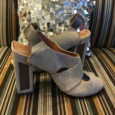 Light grey suede strappy sandal with chunky heel. This four inch strappy sandal is accentuated with beautiful silver heel detail. It's very comfortable to wear! No 704b Shoes Heels