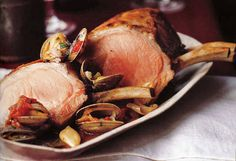 Pork and clams, a classic Portuguese combination, are paired tomatoes, garlic, herbs, and a pinch of crushed pepper. For a twist, bone-in pork loin is used.
