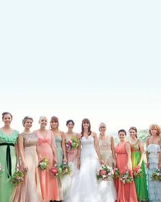 bridesmaids in a rainbow of pastel colored vintage dresses.
