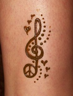 music and peace henna by merrittz henna art, via Flickr. Too cute! :)