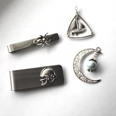 Work in progress some items might be available on our website.  Spider tie clip football money clip pearl on the moon pendant necklace sailing boat pendant. Link in bio.  Jewelrylized.com #working #workinprogress #jewelrymaking #diy #diyjewelry #tieclipforsale #tieclip #weddinggift #football #footballmoneyclip #tiebar #tiebarforsale #jewelryforsale #spidertieclip #spider #moon #boat #boatnecklace #sailing #necklaceforsale #necklace #handmadenecklace #handmade #jewelrylized