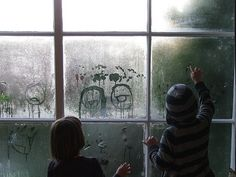 drawing faces on the foggy windows