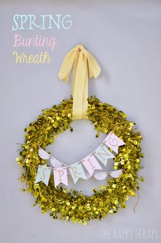 Spring Wreath from @The Happy Scraps | Find the Cricut Explore at Joann.com to make the Spring bunting