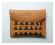 CLUTCH / caramel leather with black triangles. $45.00, via Etsy.