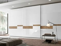 Download the catalogue and request prices of Tecnopolis anta split By presotto, sectional lacquered wardrobe with sliding doors design Pierangelo Sciuto, tecnopolis Collection