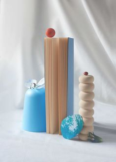 Still life image of a tall book and wooden ornaments with small balls and a flower balanced on top Indoor Photography Tips, Product Photography, Old Mirrors, Still Life Images, Wooden Ornaments, Through The Window, Camera Settings, Morning Light, Fix You
