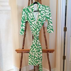Iconic DVF Green Wrap Dress Relisting this dress at a reduced price from $155 to $67 to account for small mark that I found while initially packing it for shipment.  See last photo. Other than that, the DVF Green and White Silk Wrap Dress is in Beautiful Condition.  Green and White Geometric Pattern. 3/4 Sleeves. Size 4. Fits Like 2/4. Worn Once. Diane Von Furstenberg, Iconic Wrap Dress. Diane von Furstenberg Dresses