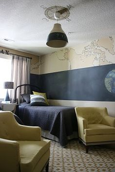like the map on the wall and the compass around the light on the ceiling - great way to tie a theme together