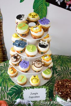 Safari / Jungle Themed First Birthday Party - Dessert Ideas: Jungle Animals Cupcakes / Jungle Animals Fondant Cupcake Toppers from lions, teddy bears, monkeys to hippos, giraffes, tigers and elephants.