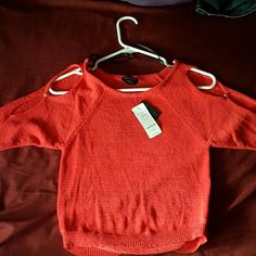 shirt red has little buttons on sleeves  (sleeves not short not long ) bebe Tops