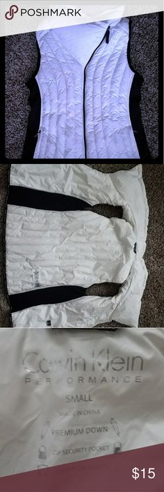 Calvin Klein Performace Down Vest A must have for those chilly morning runs! Has a place for your headphones and includes two pockets. Gently worn and still has fluffy down and no signs of wear. It is white in color with black accents along the sides Calvin Klein Jackets & Coats Vests