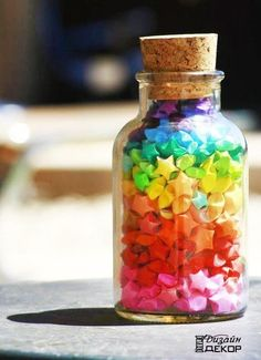Make these Origami stars using coloured paper put them into glass bottles jars for a gift! Origami Stars, Origami Owl, Origami Paper, Rainbow Origami, Bottle Charms, Bottle Art, Rainbow Star, Rainbow Colors, Rainbow Aesthetic