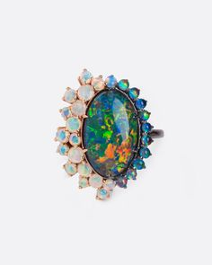 A large Australian black opal surrounded by smaller black and white opals. Set in rose gold and rhodium plated white gold. Handmade by Carla Maxine. Black Opal Ring, White Opal, White Gold, Australian Black Opal, Rustic White, Black Rhodium, Stoneware Clay, Opal Rings, 18k Rose Gold