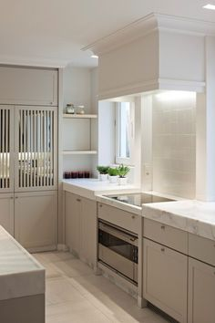 sleek, modern, classic #kitchen.  thick marble, hood profile, marble kickplate