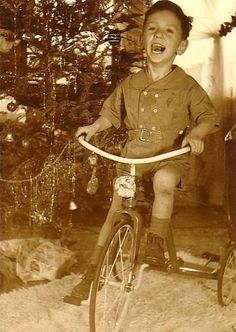 Vintage Christmas Photograph ~ Happy boy receives tricycle for Christmas.