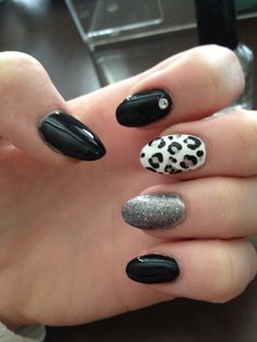 black and white with leopard print and sliver stiletto nail art design