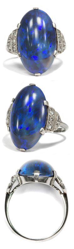 An Art Deco platinum, black opal and diamond ring, 1930s.