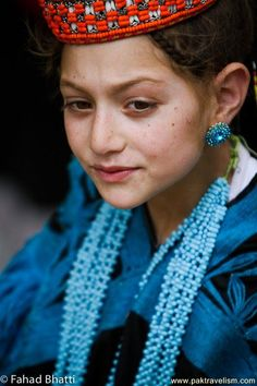 The girl is from the unique tribe Kalasha / Kalash of the Chitral District of Khyber-Pakhtunkhwa province of Pakistan, a Dardic indigenous people of the Indo-Aryan branch speaking the Kalasha language.The Nuristani people of the adjacent Nuristan ( Kafiristan) province of Afghanistan once practiced the same polytheistic religion as the Kalasha but by late 19th century most converted to Islam, secretly continuing to practice their religion while the Kalash maintained their own cultural…