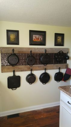Kitchen Decor Sets My Cast Iron Display Wall. My hubby rocks. :) Old Barn wood found on our new farm and tin tiles.