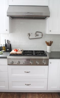 when i build my dream kitchen, it will have a gas range like this. and there will most definitely be a faucet above to fill pots with water. best idea ever.