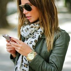 olive leather jacket, scarf, gold watch & aviators.