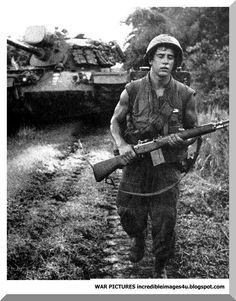 early photo, carrying a M-14 which the M-16 replaced