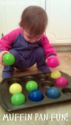 Muffin Pan Fun: Set baby up with a muffin pan or ice tray sorting activity. There are balls in this picture but any set of like objects would work. Outside, you could use pine cones.