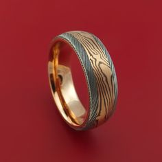 Damascus Steel Ring with Rose Gold Mokume and Rose Gold Sleeve Custom Made Band