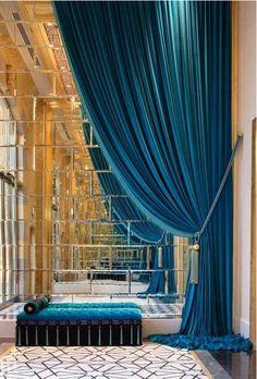 mirrored wall. blue velvet.