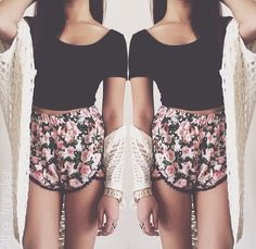 Floral dolphin shorts, black crop top, and beige slouchy cardigan