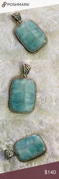 Larimar Pendant- only one! In .925 silver Larimar is a beautiful blue colored pectolite that only comes from the Dominican Republic.  This pieces is a great example of the blue to white color.  Great rectangular shaped pendant in .925 silver. Jewelry Necklaces