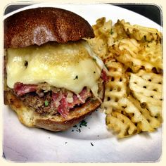 BURGER NIGHT...tonights specialty the Guinness Burger (1/2lb burger topped with sliced corned beef, sauerkraut, swiss cheese & a Guinness beer reduction sauce in a pretzel bun)