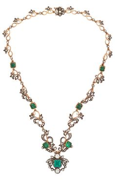 A VICTORIAN EMERALD AND DIAMOND FLORAL WREATH NECKLACE, CIRCA 1895. Comprising seven foil backed square faceted emeralds in 18k gold cut-back collet settings, old mine- and old European-cut diamonds, similarly set among silver-topped 18k gold foliate links, largest emerald 7.8 x 7.3 mm, two principal diamonds approx. 1 cts. Unmarked. #Victorian #necklace