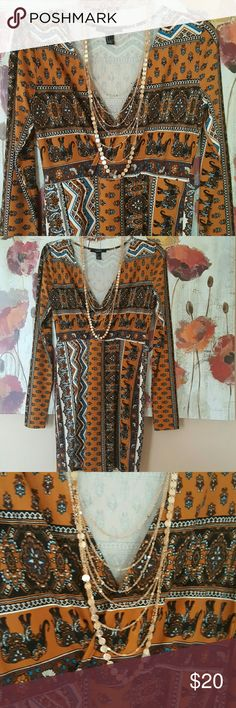 """CLEARANCE!🍸UNIQUE DESIGN STYLE DRESS🍸 Try this on for style. Beautiful design with elephant print and paisley patterns with flowers, mixed blues and browns making this dress, a very unique mix of colors. This dress is in excellent condition only worn one time. Length is 31.5"""" long, bust across is 18"""".Material is very stretchy. Accessories not included.🍸Free gift with purchase 🍸Fits like a medium. Forever 21 Dresses Mini"""