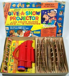 KENNER: 1962 Give-A-Show Projector.  I had this and still have a stray film strip that I've kept for old time's sake.