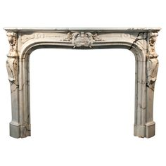 Very Beautiful Antique, Louis XV Style Firepace Made Out of Panazeau Marble | From a unique collection of antique and modern fireplaces and mantels at https://www.1stdibs.com/furniture/building-garden/fireplaces-mantels/