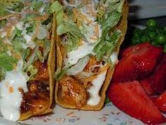 chicken ranch tacos...these come out amazing in the crockpot! use 2 lbs. of raw (not frozen) chicken breast, 1 packet of dry ranch dressing, 1 packet chicken taco seasoning & 1 can of chicken broth. put that all in the crockpot and cooked on low for 3 hours then shredded the chicken and let it cook on low another 30 min. heat the taco shells and assemble your tacos and oh my tasty eats!!!
