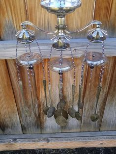 Wind chime / re-purposed flatware and silver / black and purple glass beads / garden art / steampunk home decor / silver spoon windchimeThis wind chime is a mix of disassembled silver pieces in brought back to life in more ways than one. Within its wonder, you will find two different candelabras, a pine cone candle, little silver candy dishes, a napkin ring, and a mix of antique and vintage spoons - all silver plated. The beads are in varying tones of purple, mixed in with black hematite for…