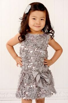 sequins, this is such a cute little party dress for a little girl, nice colour too - a total mini me!