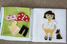 this little mum blog.  Activity book's last page and back cover.  The clothes were SO much fun to make.  Simply mounted on felt using the paper binding that glues them together when ironed. The clothes and bunny and cat are stored in the purse which has a button to fasten and to teach Ava how to open a button!