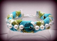 Mixed media bracelet by JMP member Randomheart. http://www.jewelrymakingprofessormembers.com